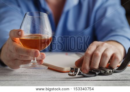 Cute Young Man Drinks Whiskey At Table
