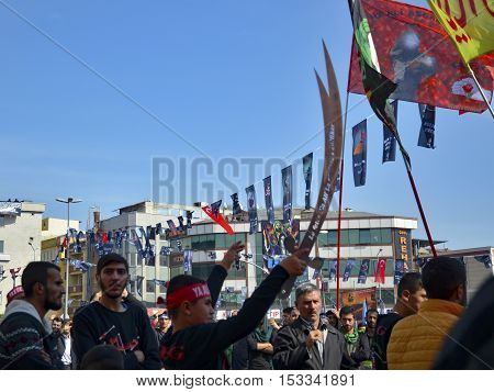 Istanbul Turkey - October 11 2016: Turkish Shia men take part in commemorations marking the mourning period of Ashura. Turkish Shia Muslims mourning for Imam Hussain. Caferis take part in a mourning procession marking the day of Ashura in Istanbul's Kucuk