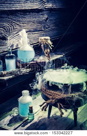 Mysterious Witcher Cauldron With Blue Smoke And Potions For Halloween