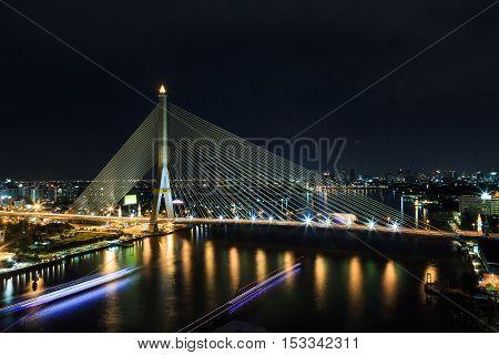 Long exposure night scene of Rama VIII bridge suspension bridge in Bangkok Thailand