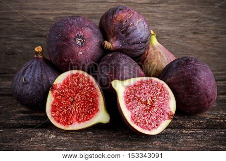 Fresh Figs slice on wooden table background.