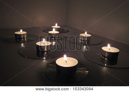Candles Placed On Compact Disks.
