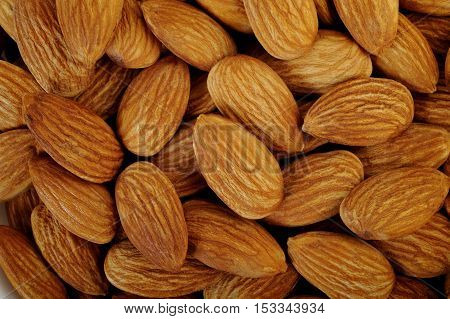 Close up almonds nuts food on background