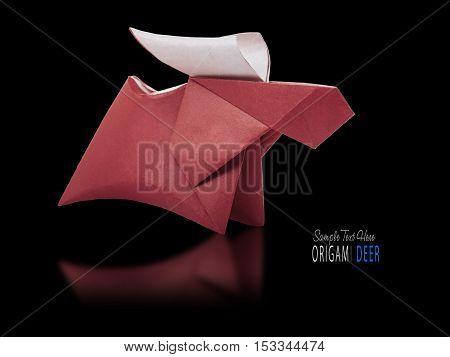 Origami paper brown deerOrigami paper brown winter christmas running deer on a black background