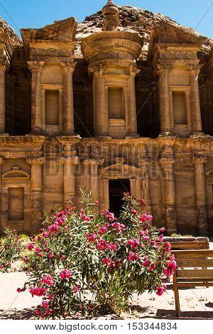 Photo of the Exterior monastery Ad Deir with oleander bush Petra Jordan, vertical