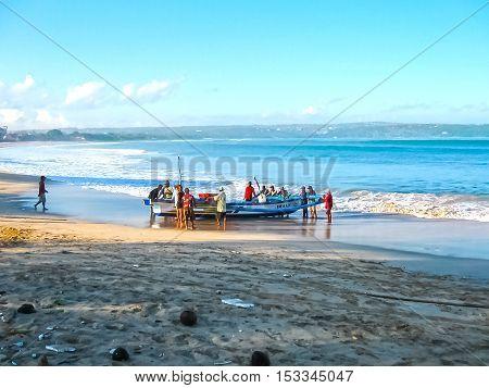 Jimbaran Bali Indonesia - April 20 2012: The loacal fishermen with fish boat at Jimbaran Beach Bali Indonesia