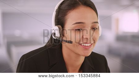 Spanish speaking customer service representative sitting at desk