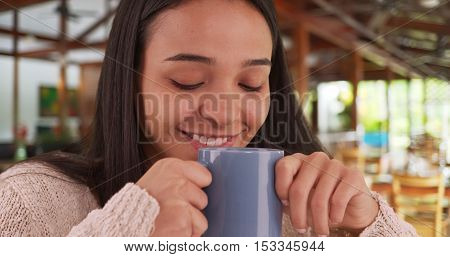 Mexican Woman Sitting In Cafe With A Nice Cup Of Coffee