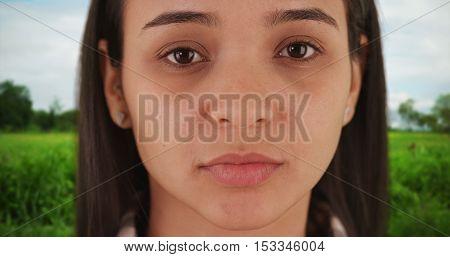 Close up of Hispanic woman looking at camera