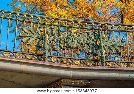 Theater bridge at the intersection of Griboyedov Canal and the Moika River in Saint Petersburg Russia - sculpture elements of bridge fence in sunny autumn day