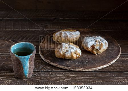 eclairs on a brown background eclairs on a ceramic plate coffee and dessert eclairs and coffee