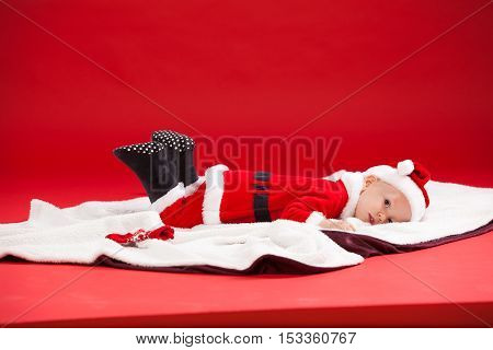 Beautiful little baby celebrates Christmas. New Year's holidays. Baby in a Christmas costume