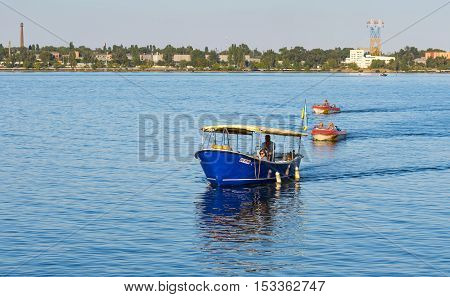 DNEPR UKRAINE - SEPTEMBER 10 2016:Motor boats with passengers running between banks of Dnepr river during City Day local activity in Dnepr, Ukraine at September 10, 2016