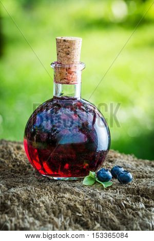 Sweet Liqueur In A Bottle With Blueberries And Alcohol
