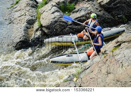 Beklenischevo, Russia - June 12, 2005: The place with the Iset River rapid current, a so-called threshold the Revun - Howler. Water sportsmen in threshold