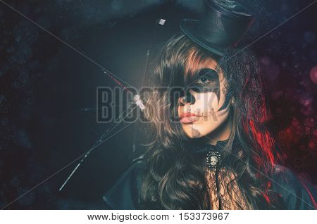 Fashion girls celebrating Halloween. Haloween costumes. Masquerade party. Holiday at October 31, 2016