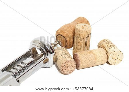 Corkscrew for wine and corks isolated on a white background