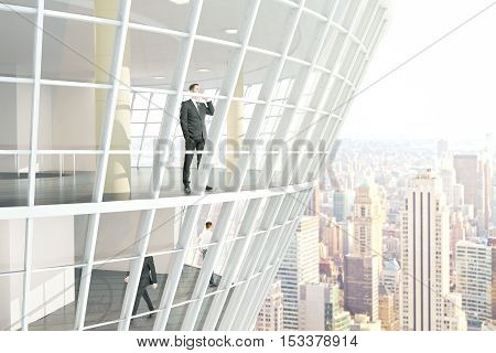 See through glass building exterior with businesspeople inside. City background. 3D Rendering