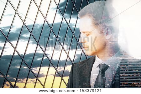 Sad pensive businessman behind iron wire mesh on sky background. Freedom concept