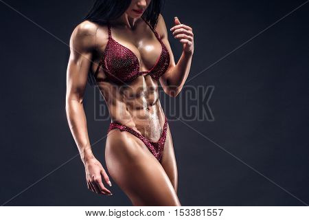 Perfect Fitness Body of Beautiful Woman in Drops. Fitness-instructor in Sports Clothing. Female Model with Fit Muscular and Slim Body in Sportswear. CloseUp.