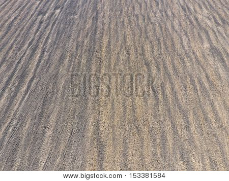 Top View Of A Plowed Field. Background Texture Of The Surface Of The Plowed Field. Shooting With Qua