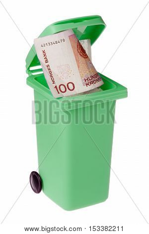 Green recycling bin with a one hundred Norwegian krona bill inside isolated on white.