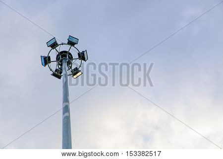 Group of Sport lights but just one sport light can operate with cloudy sky