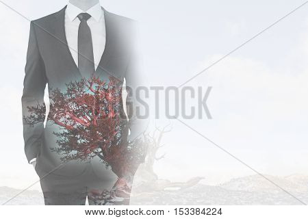 Businessman in suit on abstract background with red tree and copy space. Double exposure