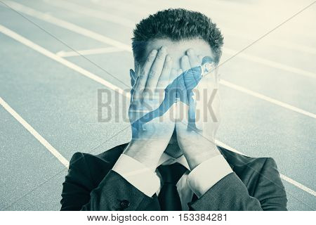 Businesspeople covering face and getting ready to run on abstract running track background. Fear of failure concept. Double exposure