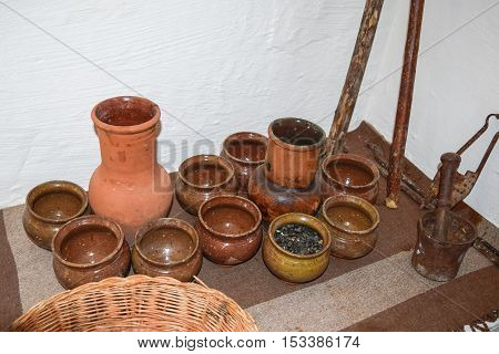 Shelves With Standing On Their Utensils Of Porcelain And Earthenware. Vintage Kitchen Utensils