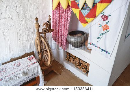 Interior Cossack Home. Spinning Wheel, Oven, Kettle, Firewood Oven And Whitewashed Walls.