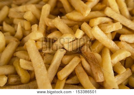 French fries fresh cooked. lots of potatoes fried. Street food, fast food. Potato fries closeup. Roasted tasty potatoes