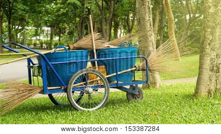 Cleaning service and green park concept - Park with handcart cleaning in cleaning service process