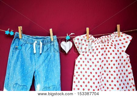Baby Clothes And Goods Hanging On The Clothesline.