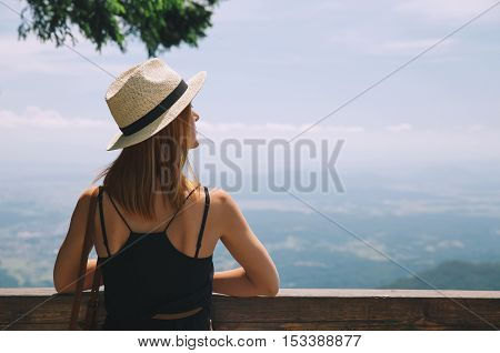 Travel Lifestyle Concept. Beautiful young woman in the mountains. Velika Planina or Big Pasture Plateau Slovenia.