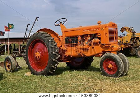 ROLLAG, MINNESOTA, Sept 1, 2016: A restored Minneapolis Moline ZB tractor hooked to a plow is displayed at the West Central Steam Threshers Reunion(WCSTR) where 1000s attend each Labor Day weekend in Rollag, MN each year.