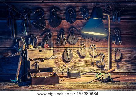 Closeup of ancient tools in old locksmiths workshop