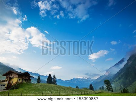 Morning at dawn in the Alps Austria Rauris. Amazing view on alpine village valley and mountains. Nature landscape