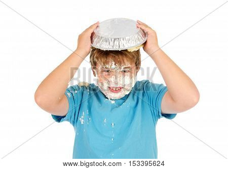 Funny Eleven Year Old Boy with a Cream Pie on top of his head.  He has whipped cream all over his face