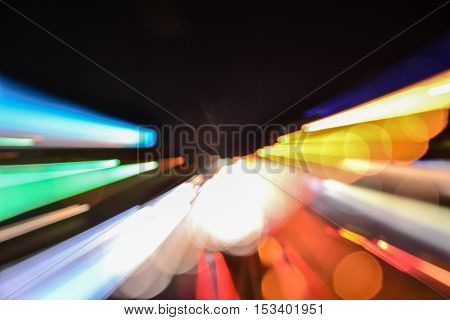 Speed accelerating blurred motion abstract multicolored background