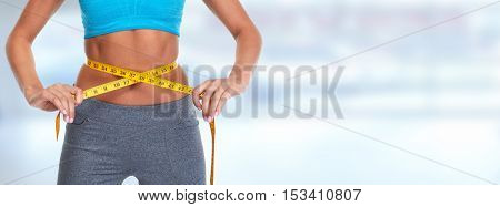 Abdomen with measuring tape.