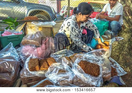 Kota Belud,Sabah-Oct 23,2016:Local tobacco sellers kirai,Sabah local tobacco at Kota Belud,Sabah.It is a place where all farmers,fishermen & vendors gathers weekly to sell their products.