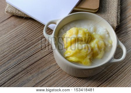 Durian, Thai Dessert Thai Cuisine Sticky Rice with Durian on Wood Background and White Paper Famous Thai Dessert