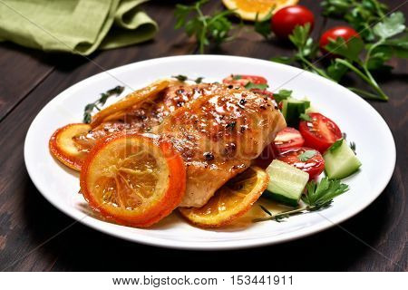Chicken breast with orange sauce and vegetable salad