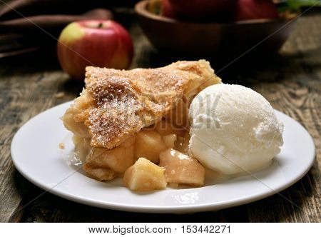 Piece of apple pie served with ice cream fruit baking