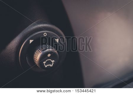 Close up image of an automatic side mirror adjustment buttons.