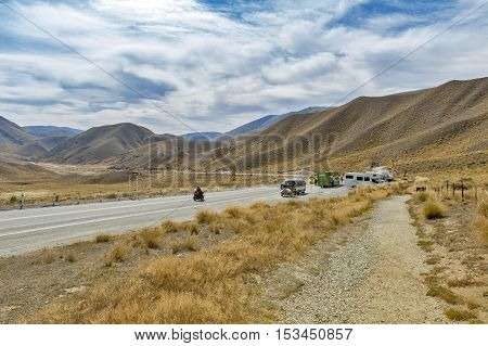 Otago New Zealand - February 2016: Scenic lookout of Lindis Pass on State Highway 8 (Tarras - Omarama - Lindis Pass Road) lies between the valleys of the Lindis and Ahuriri Rivers south island of New Zealand.