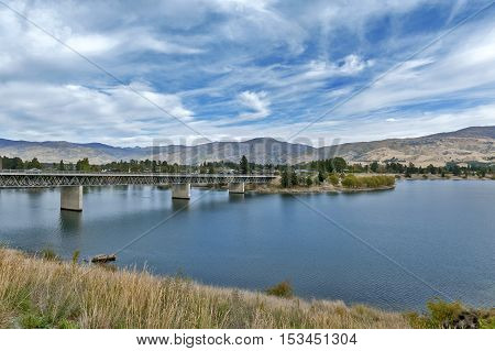 Bridge over the Kawarau River and Lake Dunstan in the township of Cromwell Central Otago New Zealand