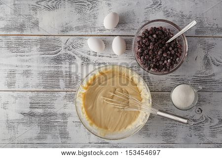 Ingredients for baking cake on wooden table