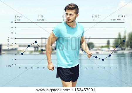 Young man jogging near river. Graphic of training results. Health care and sport concept